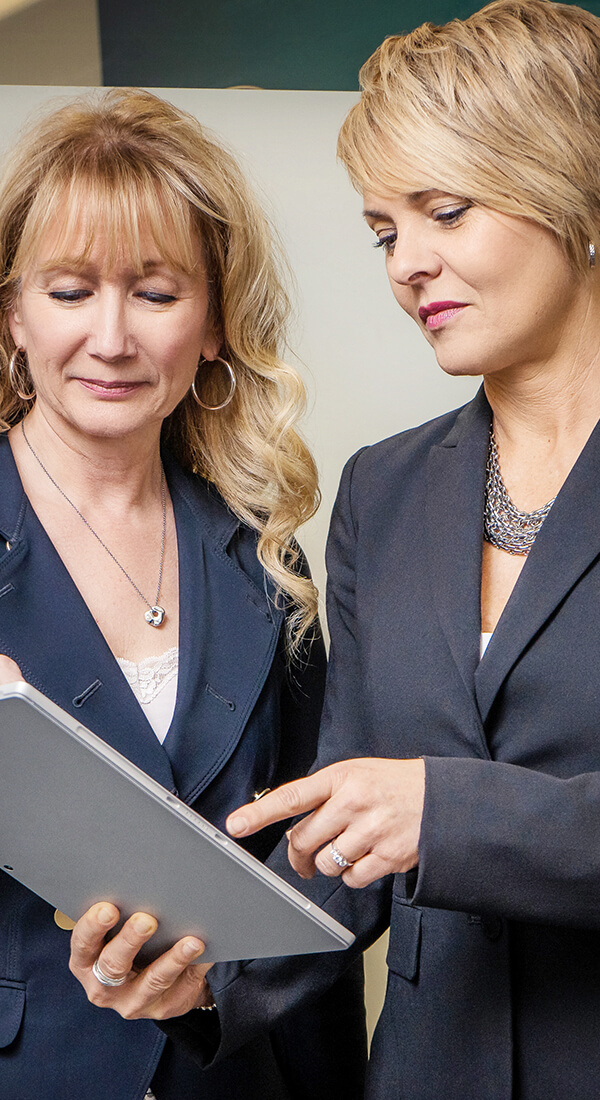 Business women looking at tablet